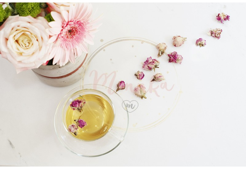 A cup of healthy herbal tea with dried roses. Beautiful fresh flowers on light marble table, top view. Pink roses and gerberas on a female work desk. Blogger lifestyle - DIGITAL DOWNLOAD PHOTOGRAPHY