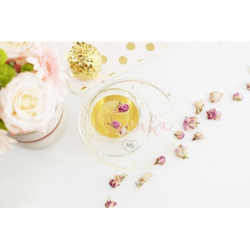 A cup of healthy herbal tea with dried roses. Beautiful fresh flowers, golden pineapple, notebook on light marble table, top view. Pink roses and gerberas on a female work desk. Blogger lifestyle - DIGITAL DOWNLOAD PHOTOGRAPHY