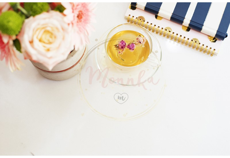 A cup of healthy herbal tea with dried roses. Beautiful fresh flowers, notebooks on light marble table, top view. Pink roses and gerberas on a female work desk. Blogger lifestyle - DIGITAL DOWNLOAD PHOTOGRAPHY