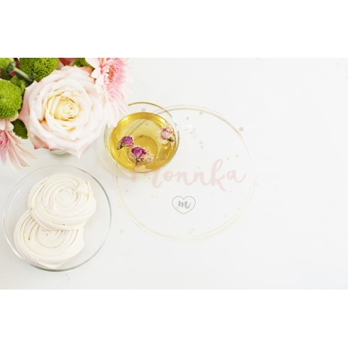 A cup of healthy herbal tea with dried roses. Beautiful fresh flowers, French meringue cookies on light marble table, top view. Pink roses and gerberas on a female work desk. Blogger lifestyle - DIGITAL DOWNLOAD PHOTOGRAPHY