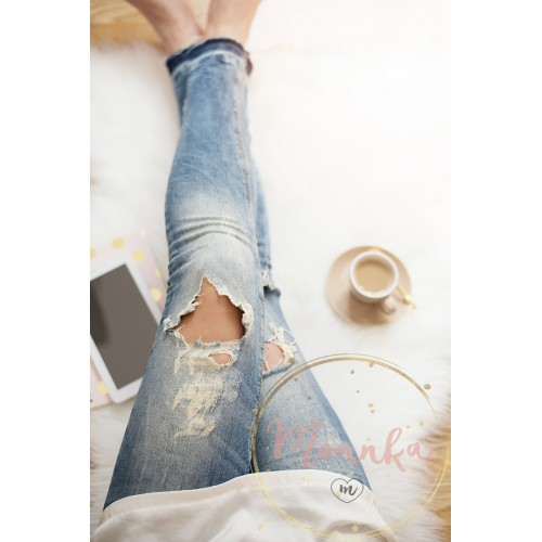 A young woman wearing distressed jeans sitting on wood floor on a white fur carpet at home. Around a cup of coffee, tablet and notebooks. Gold bright feminine theme - DIGITAL DOWNLOAD PHOTOGRAPHY