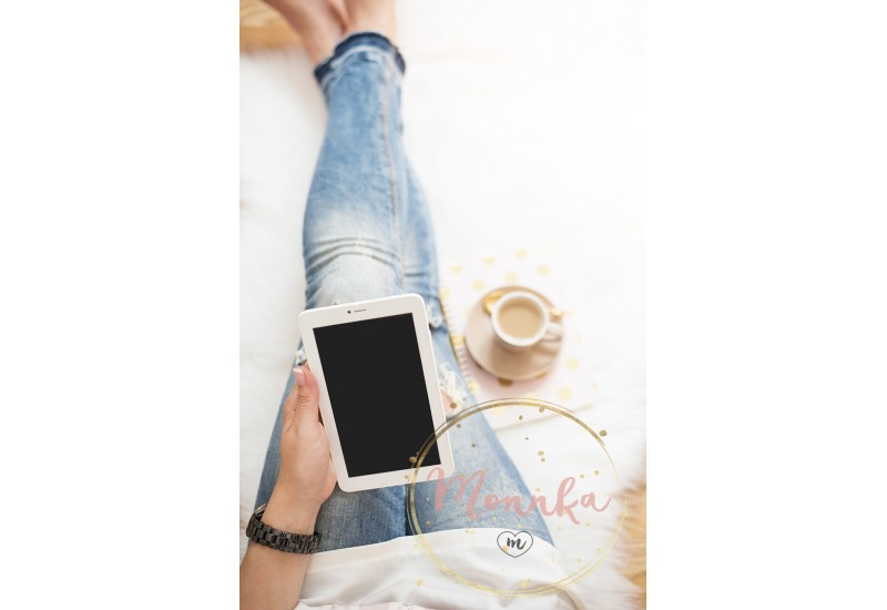 A young woman wearing distressed jeans sitting on wood floor on a white fur carpet at home and holds a tablet in his hand. Around a cup of coffee, notebooks. Gold bright feminine theme - DIGITAL DOWNLOAD PHOTOGRAPHY
