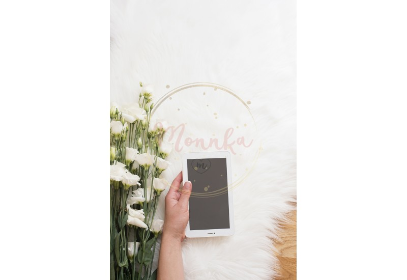 A young woman on wood floor on a white fur carpet at cozy home and holds a tablet in his hand. A large bouquet white flowers. Bright feminine theme. Vertical image - DIGITAL DOWNLOAD PHOTOGRAPHY